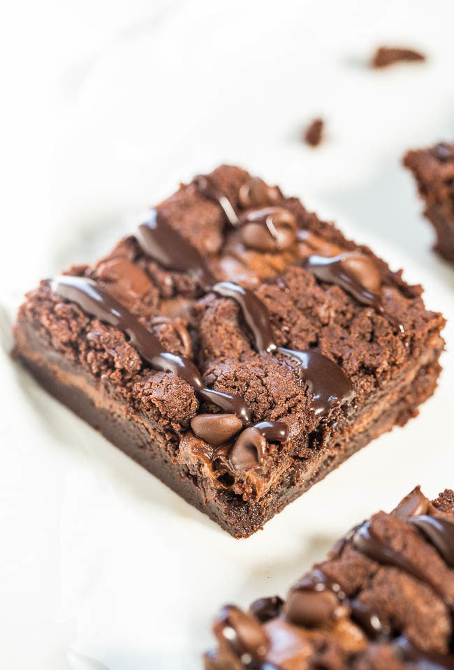 Fudgy Nutella Triple Chocolate Brownies - NO eggs, NO oil, NO gluten and you'll never miss them!!! Stuffed with Nutella, chocolate chips, and topped hot fudge! Fast, easy, and tastes amazing!!